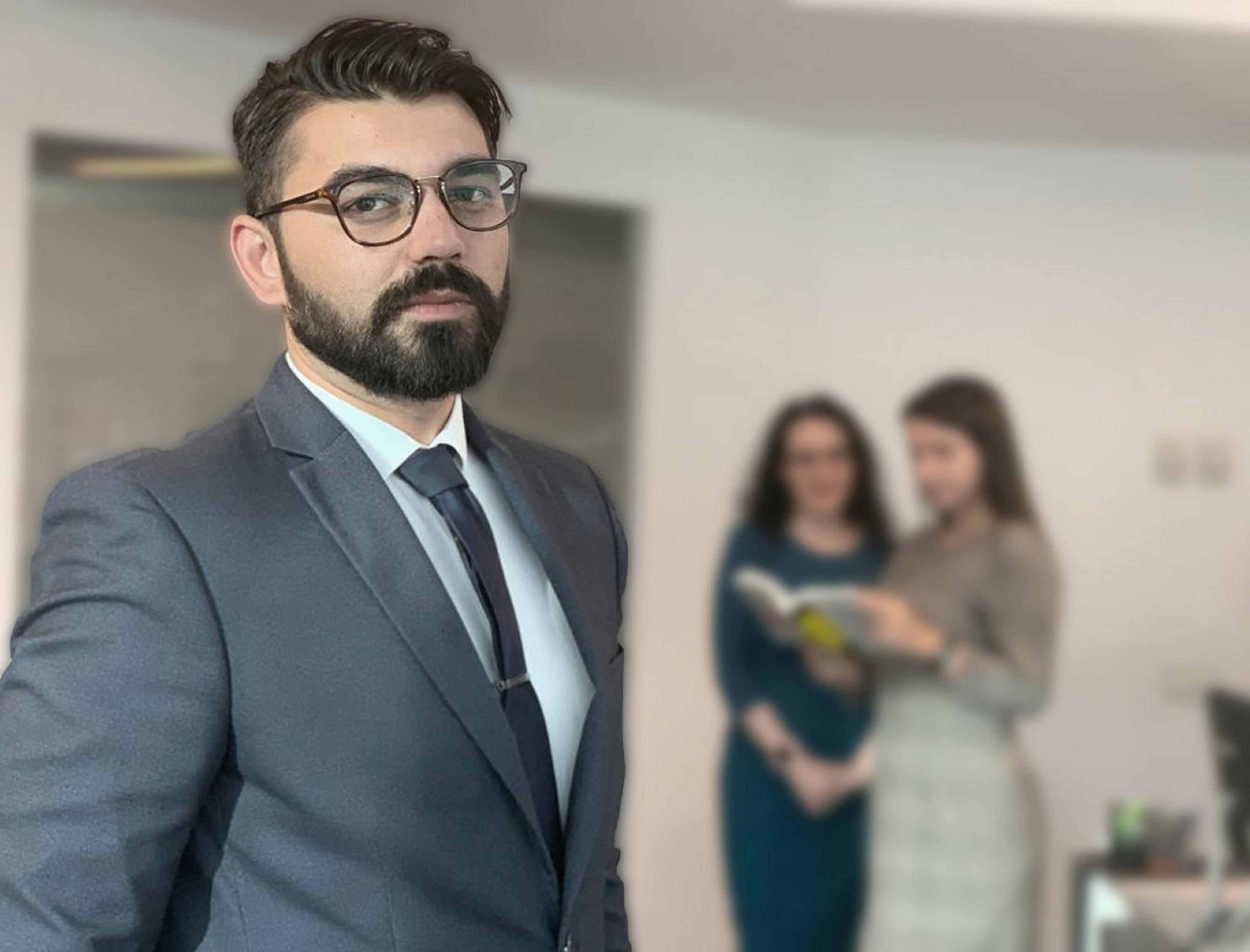Vlad Dumitru Associate ONV LAW blurred. bun